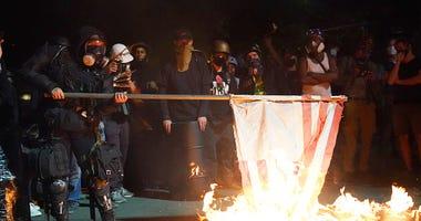 Portland riots burning American flag