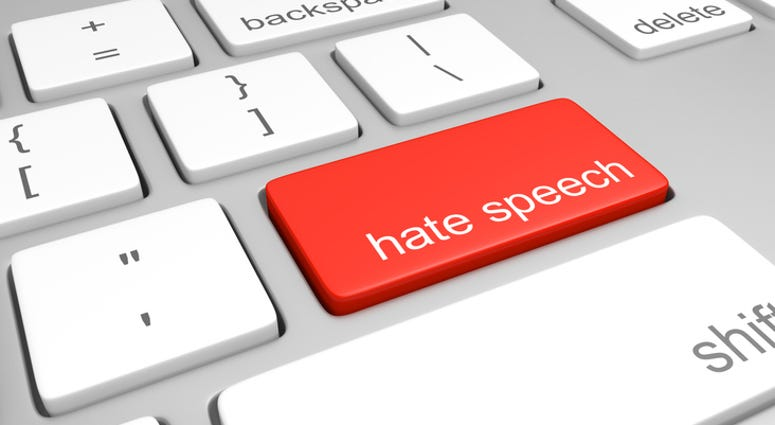 computer keyboard with one key labeled for hate speech, representing discriminatory messages that plague online message boards and comment areas.
