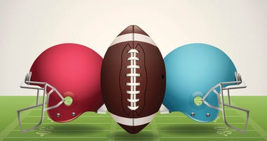 A vector illustration of an American Football field, football, and helmets. Vector EPS 10.