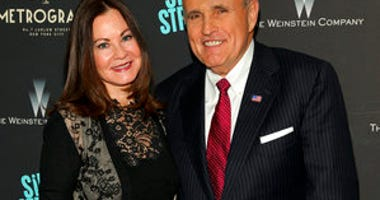 "FILE - In this Tuesday, April 12, 2016, file photo, Judith Giuliani, left, and former New York mayor Rudy Giuliani, right, attend the premiere of ""Sing Street"" at Metrograph, in New York. (Photo by Andy Kropa/Invision/AP, File)"