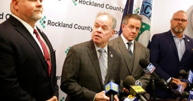Rockland County Executive Ed Day, second from left, speaks at a news conference in New City, N.Y., Monday, Dec. 30, 2019.  (AP Photo/Seth Wenig)