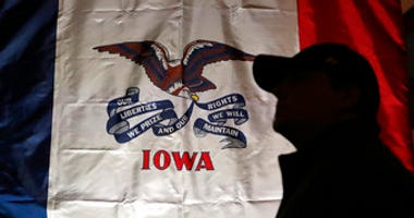 FILE - In this March 8, 2019, file photo, an audience member arrives at a rally for 2020 Democratic presidential candidate at the University of Iowa in Iowa City, Iowa. (AP Photo/Charlie Neibergall, File)