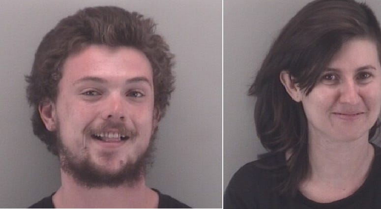 Dometrius Holden and Gabrielle Heinlein are accused of assaulting an officer