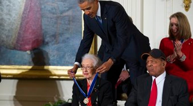 FILE - In this Nov. 24, 2015 photo, Willie Mays, right, looks on as President Barack Obama presents the Presidential Medal of Freedom to NASA mathematician Katherine Johnson during a ceremony at the White House. (AP Photo/Evan Vucci, File)