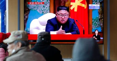 People watch a TV screen showing a news program reporting about North Korean leader Kim Jong Un with a file image at the Seoul Railway Station in Seoul, South Korea, Tuesday, April 21, 2020. (AP Photo/Lee Jin-man)