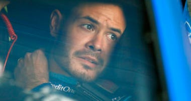 FILE - In this Oct. 18, 2019, file photo, Kyle Larson sits in his car before the final practice for a NASCAR Cup Series auto race at Kansas Speedway in Kansas City, Kan. (AP Photo/Colin E. Braley, File)