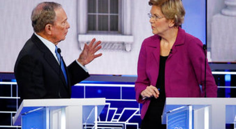 Democratic presidential candidate, former New York City Mayor Mike Bloomberg talks with Sen. Elizabeth Warren, D-Mass., during a break at a Democratic presidential primary debate Wednesday, Feb. 19, 2020, in Las Vegas. (AP Photo/John Locher)