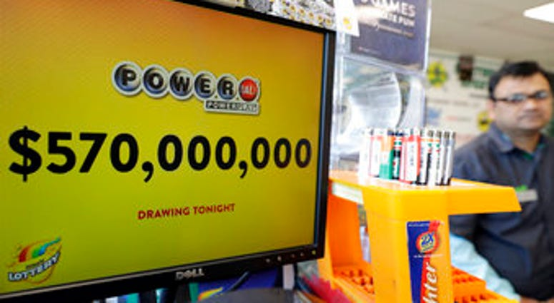 FILE - In this Jan. 6, 2018 file photo, a Powerball lottery sign displays the lottery prizes at a convenience store in Chicago. Lottery jackpots are going to shrink as the coronavirus pandemic tamps down lottery sales. (AP Photo/Nam Y. Huh File)