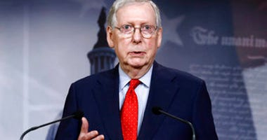 FILE - In this April 21, 2020, file photo Senate Majority Leader Mitch McConnell of Ky., speaks with reporters after the Senate approved a nearly $500 billion coronavirus aid bill on Capitol Hill in Washington. (AP Photo/Patrick Semansky, File)