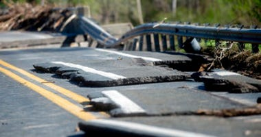 Damages on one of two North M-30 bridges on Wednesday, May 20, 2020 in Edenville Township north of Midland. (Jake May/The Flint Journal, MLive.com via AP)