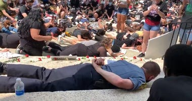 Massachusetts police chief lies face down with protesters