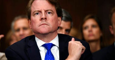 FILE - In this Sept. 27, 2018, file photo, then-White House counsel Don McGahn listens as Supreme court nominee Brett Kavanaugh testifies before the Senate Judiciary Committee on Capitol Hill in Washington.  (Saul Loeb/Pool Photo via AP, File)