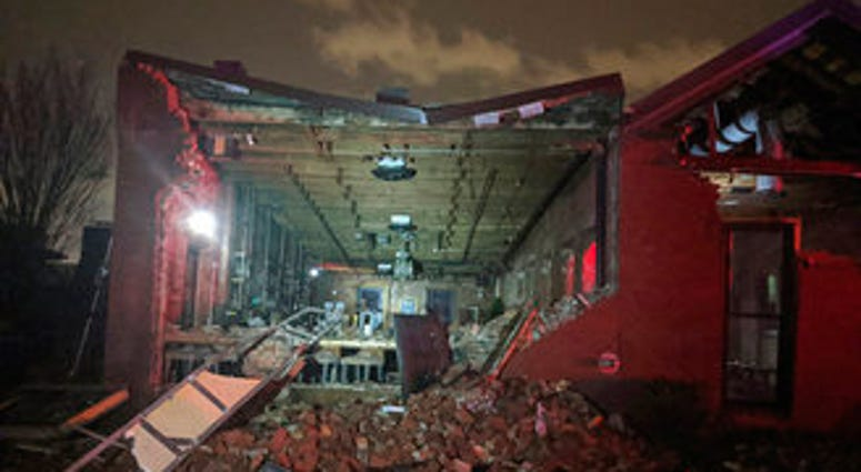 Bricks from a collapsed wall of the Geist restaurant litter the ground after a tornado touched down in downtown Nashville, Tuesday, March 3, 2020. (Alex Carlson via AP)