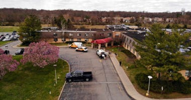 Ambulance crews are parked outside Andover Subacute and Rehabilitation Center in Andover, N.J., on Thursday April 16, 2020. (AP Photo/Ted Shaffrey)