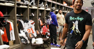 FILE - In this Dec. 30, 2019, file photo, Cleveland Browns defensive end Myles Garrett walks through the locker room at the NFL football team's training camp facility in Berea, Ohio. (AP Photo/Tony Dejak, File)