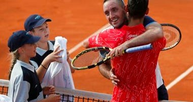 In this Saturday, June 13, 2020 photo, Serbia's Novak Djokovic, front right, hugs with Serbia's Viktor Troicki after their match of the Adria Tour charity tournament in Belgrade, Serbia. (AP Photo/Darko Vojinovic)