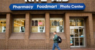 FILE - In this Oct. 21, 2016, photo, a man walks past a Rite Aid in Philadelphia. Pharmacy chains, including Rite Aid, are fighting claims that they're to blame for the opioid crisis in two Ohio counties. (AP Photo/Matt Rourke, File)