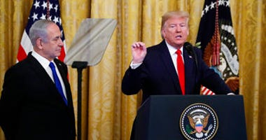 President Donald Trump, joined by Israeli Prime Minister Benjamin Netanyahu, speaks during an event in the East Room of the White House in Washington, Tuesday, Jan. 28, 2020. (AP Photo/Alex Brandon)