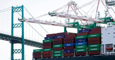 FILE - In this June 19, 2019, file photo a cargo ship is docked at the Port of Los Angeles. On Nov. 27, the Commerce Department issues the second estimate of how the U.S. economy performed in the July-September quarter. (AP Photo/Marcio Jose Sanchez, File