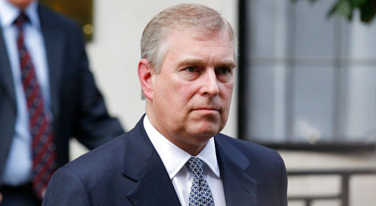 FILE - In this Wednesday, June 6, 2012 file photo, Britain's Prince Andrew leaves King Edward VII hospital in London after visiting his father Prince Philip. (AP Photo/Sang Tan, file)