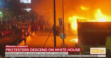 Protests burning building