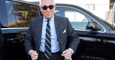 FILE - In this Nov. 6, 2019 file photo, Roger Stone arrives at Federal Court for the second day of jury selection for his federal trial, in Washington. (AP Photo/Cliff Owen)