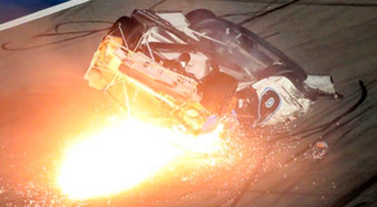 Ryan Newman slides down the track after he was involved in a crash on the final lap of the NASCAR Daytona 500 auto race at Daytona International Speedway, Monday, Feb. 17, 2020, in Daytona Beach, Fla. (AP Photo/David Graham)