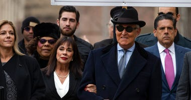 Roger Stone with accompanied by his wife Nydia Stone, second from left, arrives at federal court in Washington, Thursday, Feb. 20, 2020. (AP Photo/Manuel Balce Ceneta)