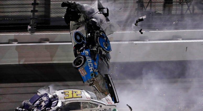 Ryan Newman (6) goes airborne after crashing into Corey LaJoie (32) during the NASCAR Daytona 500 auto race Monday, Feb. 17, 2020, at Daytona International Speedway in Daytona Beach, Fla. Sunday's running of the race was postponed. (AP Photo/Chris O'Meara