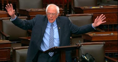 In this image from video, Sen. Bernie Sanders, I-Vt., speaks on the Senate floor at the U.S. Capitol in Washington, Wednesday, March 25, 2020. (Senate Television via AP)