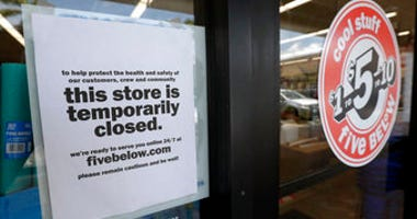 FILE - In this file photo, a sign is posted on a closed store in North Miami, Fla. (AP Photo/Wilfredo Lee, File)