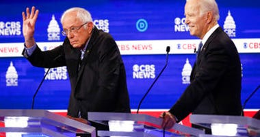 Democratic presidential candidates, Sen. Bernie Sanders, I-Vt., left, and former Vice President Joe Biden, right, participate in a Democratic presidential primary debate at the Gaillard Center in Charleston, S.C. (AP Photo/Patrick Semansky)