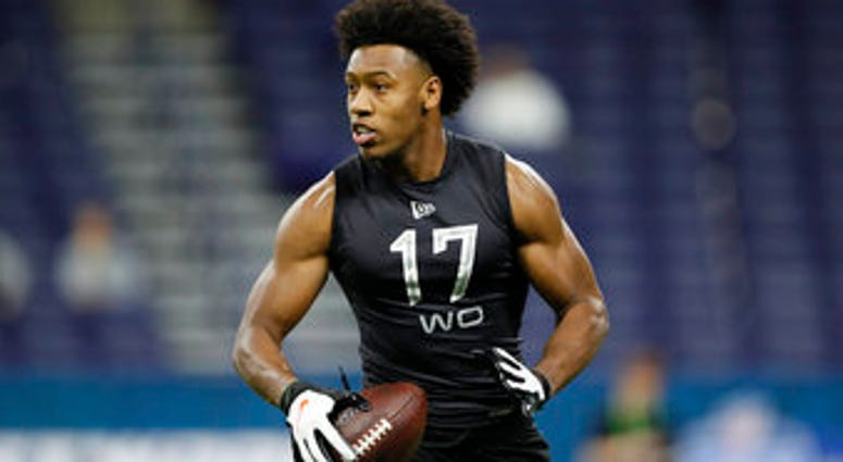 FILE - In this Feb. 27, 2020, file photo, Liberty wide receiver Antonio Gandy-Golden runs a drill at the NFL football scouting combine in Indianapolis. (AP Photo/Charlie Neibergall, File)