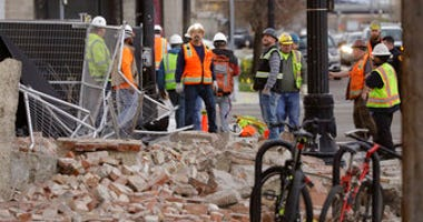 Construction workers looks at the rubble from a building after an earthquake Wednesday, March 18, 2020, in Salt Lake City. A 5.7-magnitude earthquake has shaken the city and many of its suburbs. (AP Photo/Rick Bowmer)