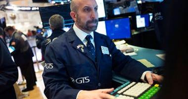 James Denaro monitors stock prices at the New York Stock Exchange, Wednesday, Feb. 26, 2020. (AP Photo/Mark Lennihan)
