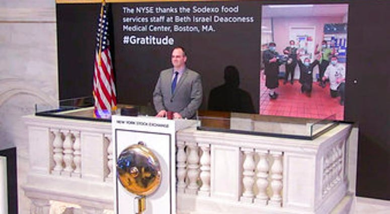 In this image taken from video provided by the New York Stock Exchange, Tommy Gannon, Assistant Supervisor, Facilities, rings the opening bell at the NYSE. (New York Stock Exchange via AP)