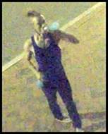 The male in the dark blue tank top is suspected of arson for an incident that occurred in the alley in the 500 block of North Harrison Street on May 31, 2020. (Credit: RPD)