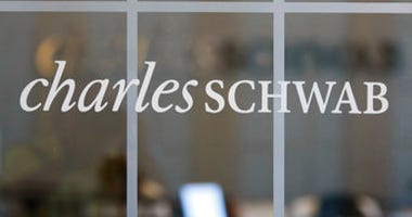 FILE - This July 14, 2010, file photo, shows a Charles Schwab office in Oakland, Calif. Charles Schwab is buying TD Ameritrade for $26 billion, a blockbuster deal accelerated by disruption in the online brokerage industry. (AP Photo/Paul Sakuma, File)