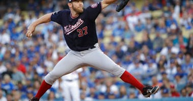 FILE - In this Oct. 9, 2019, file photo, Washington Nationals starting pitcher Stephen Strasburg throws to a Los Angeles Dodgers batter during the first inning in Game 5 of a baseball National League Division Series. (AP Photo/Marcio Jose Sanchez, File)