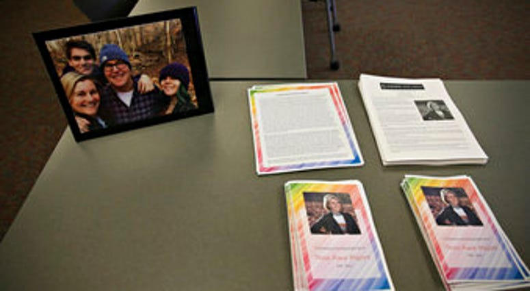 FILE - In this Dec. 21, 2019 file photo, photos, articles and letters are laid out on display before a ceremony honoring Tessa Majors at St. Anne's Belfield School in Charlottesville, Va. (Erin Edgerton/The Daily Progress via AP, File)
