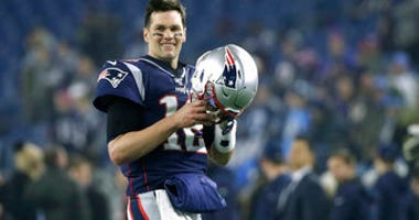 FILE - In this Jan. 4, 2020, file photo, New England Patriots quarterback Tom Brady warms up before an NFL wild-card playoff football game against the Tennessee Titans in Foxborough, Mass. (AP Photo/Elise Amendola, FIle)