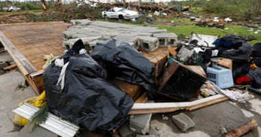 Bags of recovered clothing rest on what remains of the floor in Mama D's Bar and Grill in Bassfield, Miss., Monday, April 13, 2020. (AP Photo/Rogelio V. Solis)