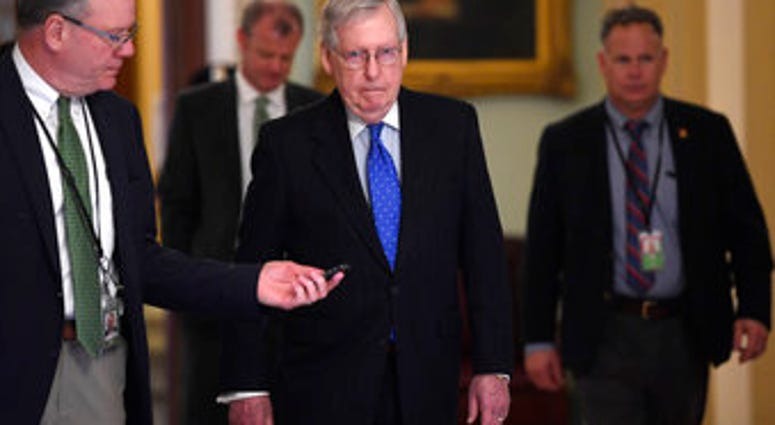 Senate Majority Leader Mitch McConnell of Ky., walks back to his office on Capitol Hill in Washington, Tuesday, March 17, 2020. (AP Photo/Susan Walsh)