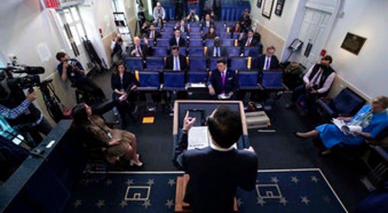 Treasury Secretary Steven Mnuchin speaks about the coronavirus in the James Brady Press Briefing Room of the White House, Tuesday, April 21, 2020, in Washington. (AP Photo/Alex Brandon)