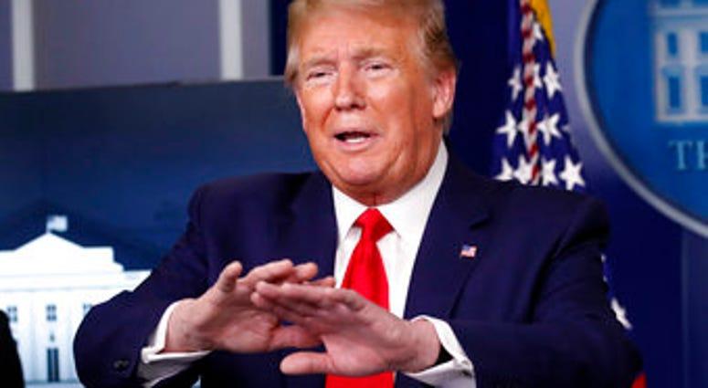 President Donald Trump speaks about the coronavirus in the James Brady Press Briefing Room of the White House, Monday, April 20, 2020, in Washington. (AP Photo/Alex Brandon)