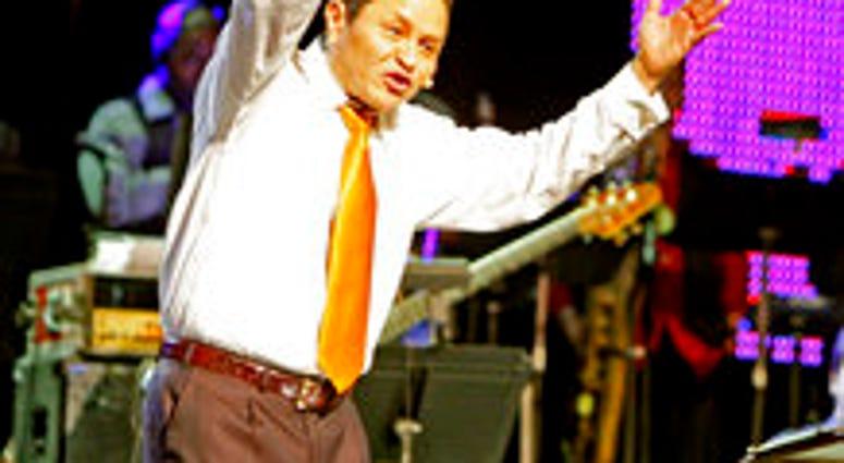 Guillermo Maldonado, pastor of King Jesus International Ministry Church, speaks to the crowd, Friday, October 9th, 2009 in Miami. Maldonado will host President Donald Trump at a rally this week. (Charles Trainor Jr./The Miami Herald via AP)