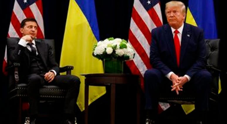 FILE - In this Sept. 25, 2019, file photo, President Donald Trump meets with Ukrainian President Volodymyr Zelenskiy at the InterContinental Barclay New York hotel during the United Nations General Assembly, in New York. (AP Photo/Evan Vucci, File)
