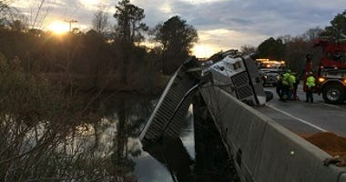 A tractor trailer hangs over the side of Route 60 at the Chickahominy River.  (Virginia State Police)