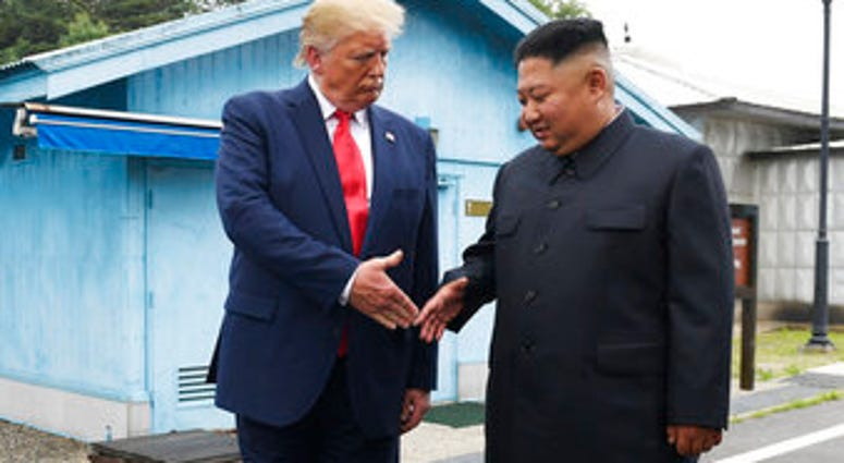 FILE - In this June 30, 2019, file photo, U.S. President Donald Trump meets with North Korean leader Kim Jong Un at the border village of Panmunjom in the Demilitarized Zone, South Korea. (AP Photo/Susan Walsh, File)
