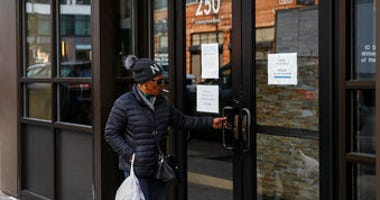 Visitors are unable to gain access to the Department of Labor due to closures over coronavirus concerns, Wednesday, March 18, 2020, in New York. (AP Photo/John Minchillo)